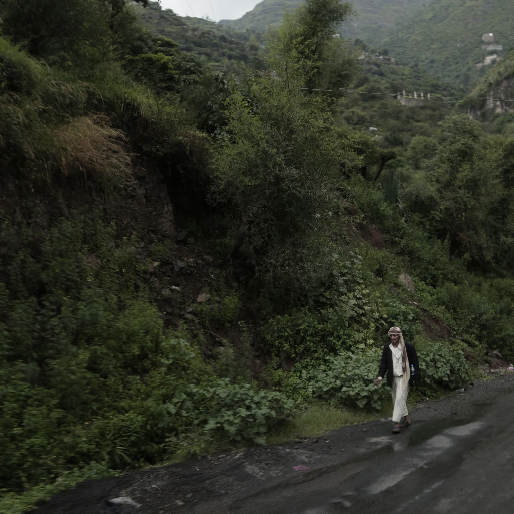A man walks down a road in Ibb, Yemen, on Aug. 3, 2018. (AP Photo/Nariman El-Mofty)