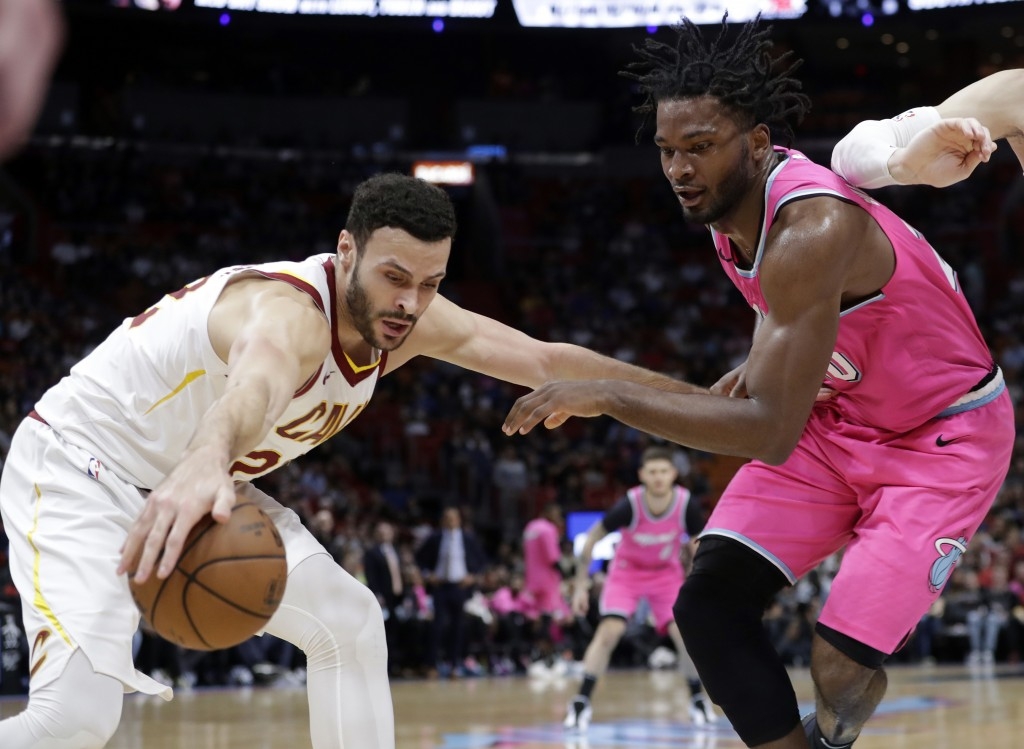 Cleveland Cavaliers forward Larry Nance Jr. (22) and Miami Heat forward Justise Winslow go for the ball during the first half of an NBA basketball gam...