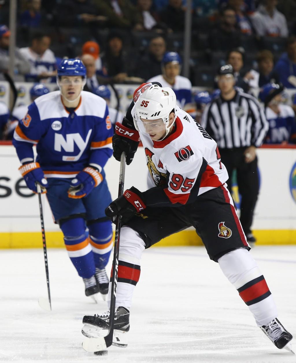 Ottawa Senators center Matt Duchene (95) plays the puck against the New York Islanders during the first period of an NHL hockey game, Friday, Dec. 28,...