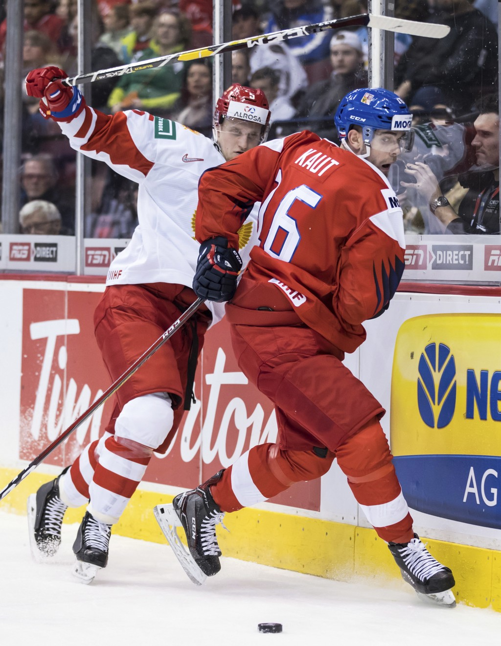 Czech Republic's Martin Kaut (16) and Russia's Dmitri Samorukov (5) collide during third-period IIHF world junior hockey championship game action in V...