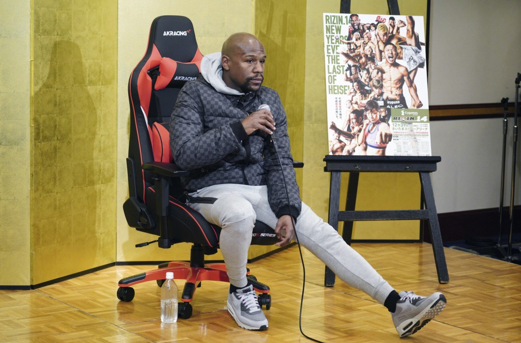 Floyd Mayweather Jr. listens a question from media during a news conference in Tokyo Saturday, Dec. 29, 2018. Mayweather is scheduled to fight Japanes...