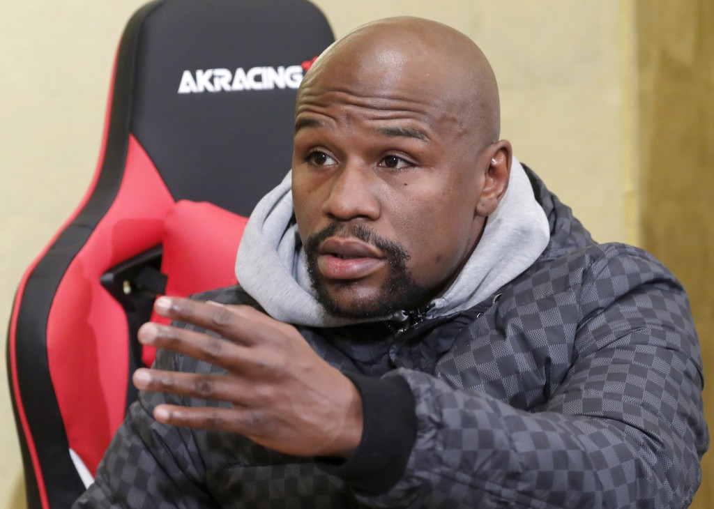 Floyd Mayweather Jr. gestures during a news conference in Tokyo Saturday, Dec. 29, 2018.  Mayweather is scheduled to fight Japanese kickboxer Tenshin ...