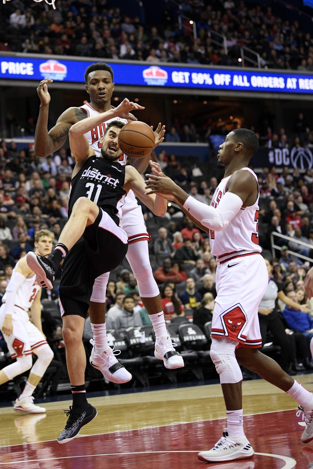 Washington Wizards guard Tomas Satoransky (31), of the Czech Republic, loses the ball against Chicago Bulls forward Wendell Carter Jr., back, and guar...