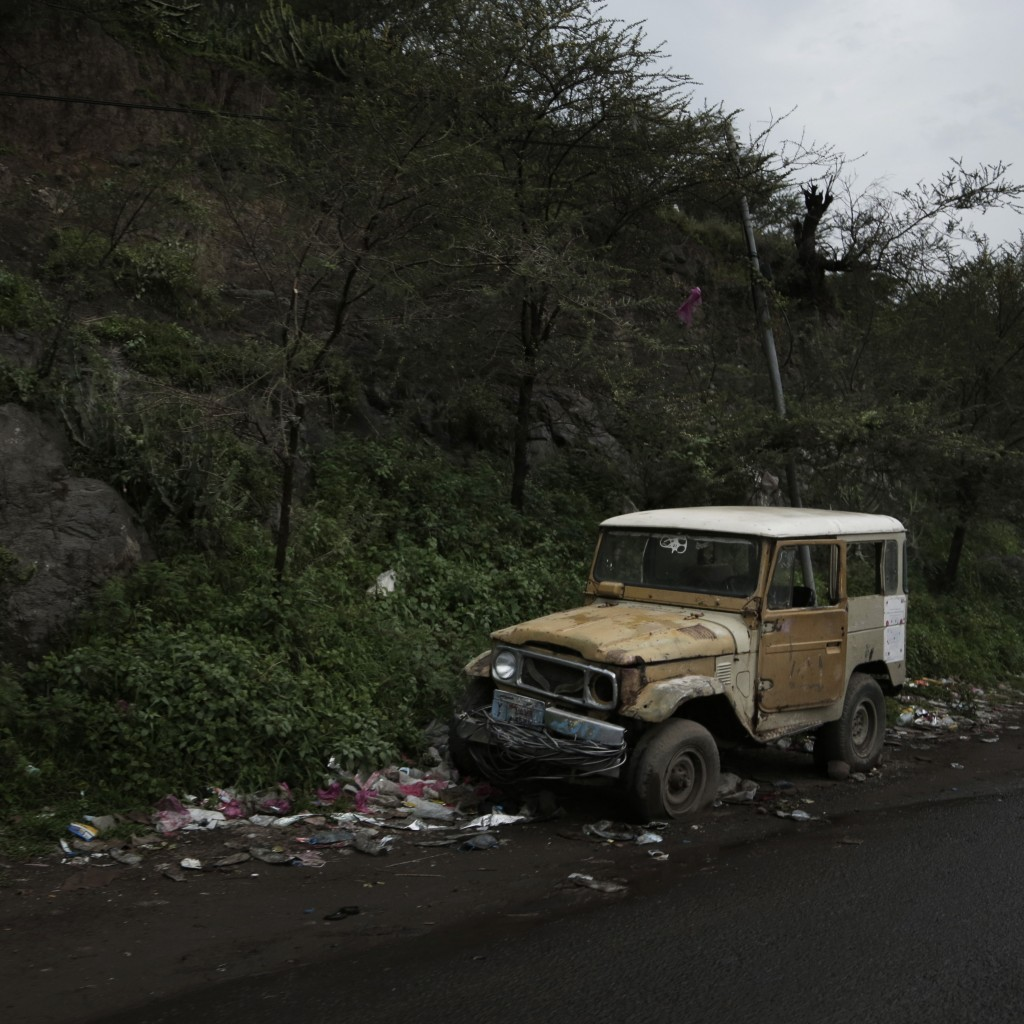 This Aug. 3, 2018 photo shows a damaged vehicle abandoned on a road in Ibb, Yemen. (AP Photo/Nariman El-Mofty)