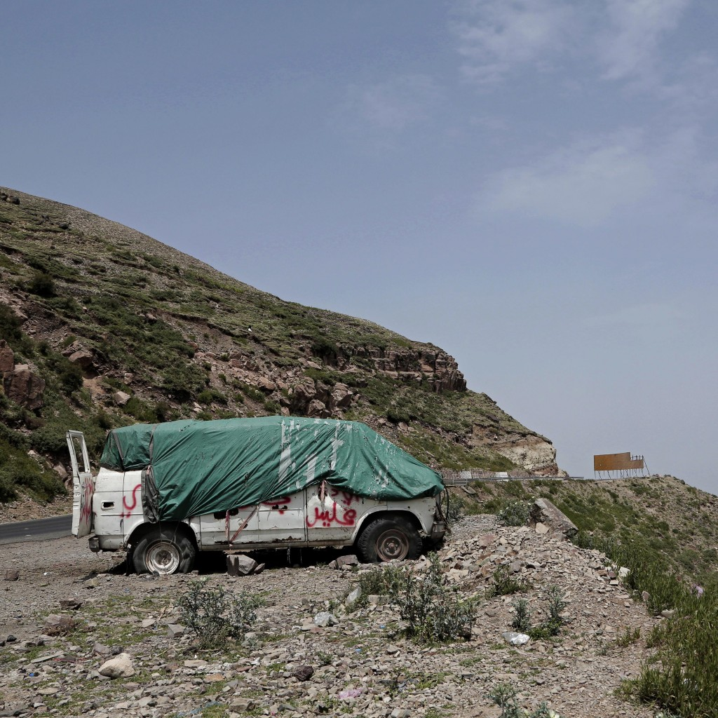This Aug. 3, 2018 photo shows a damaged vehicle on the roadside in Ibb, Yemen. (AP Photo/Nariman El-Mofty)