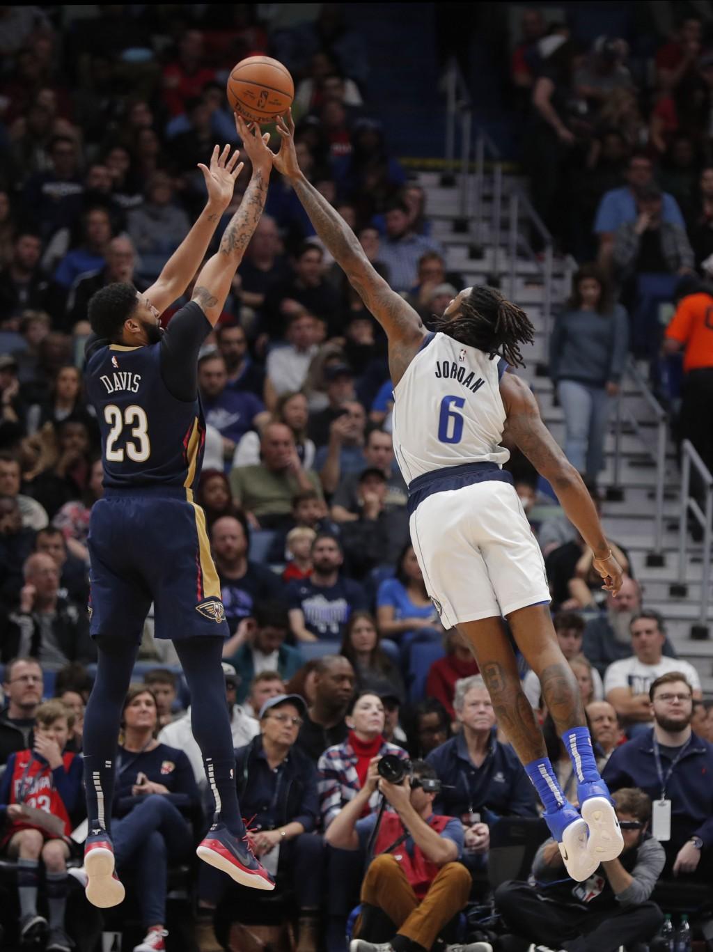 Dallas Mavericks center DeAndre Jordan (6) blocks a shot by New Orleans Pelicans forward Anthony Davis (23) during the first half of an NBA basketball...