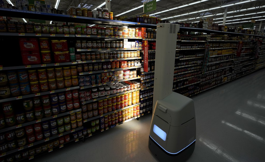 FILE - In this Nov. 9, 2018, file photo, a Bossa Nova robot scans shelves to help provide associates with real-time inventory data at a Walmart Superc...