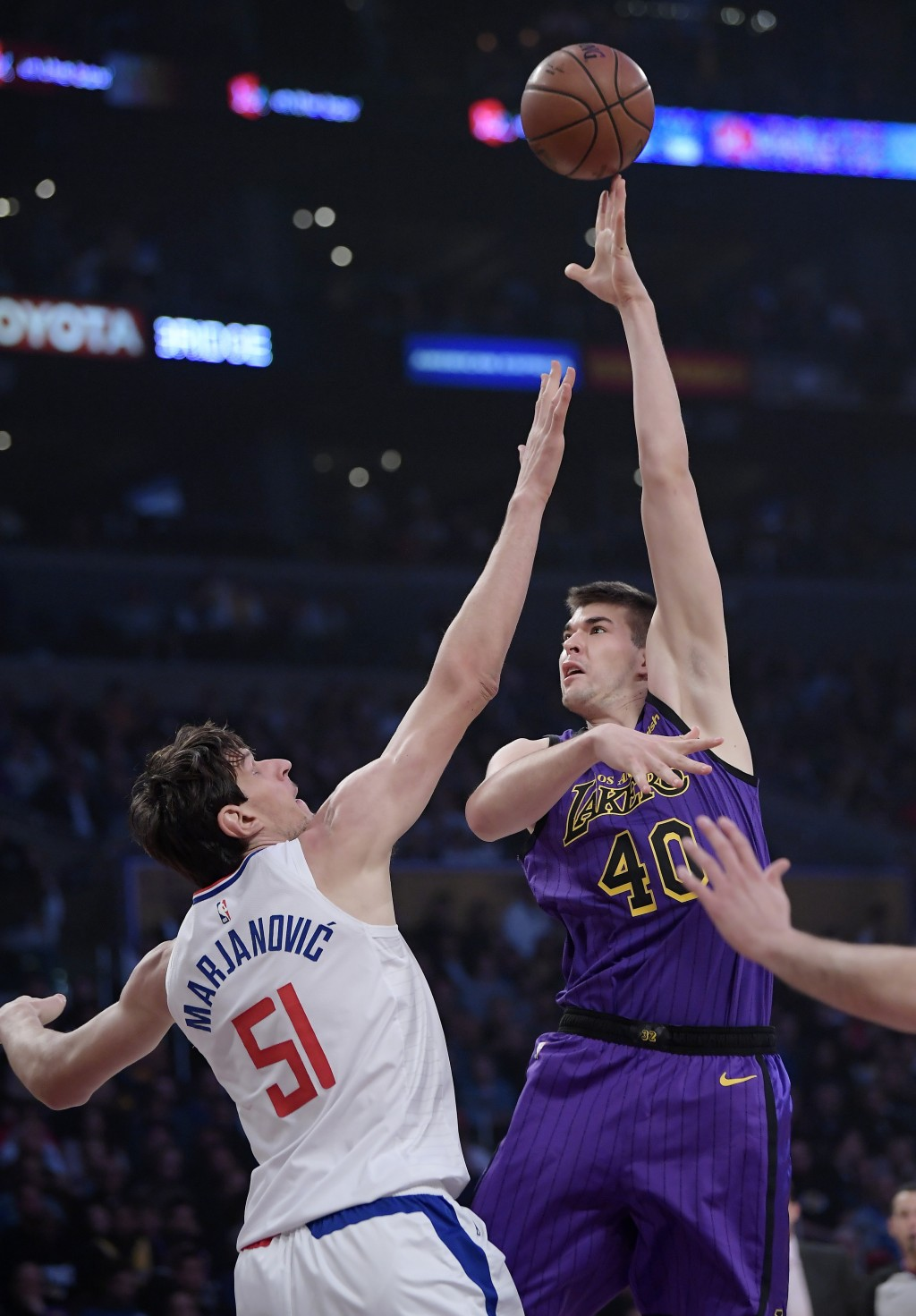 Los Angeles Lakers center Ivica Zubac, right, shoots as Los Angeles Clippers center Boban Marjanovic defends during the first half of an NBA basketbal...