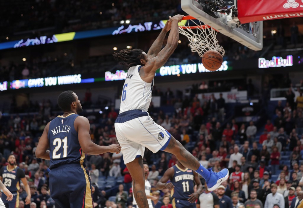 Dallas Mavericks center DeAndre Jordan (6) dunks in front of New Orleans Pelicans forward Darius Miller (21) during the first half of an NBA basketbal...