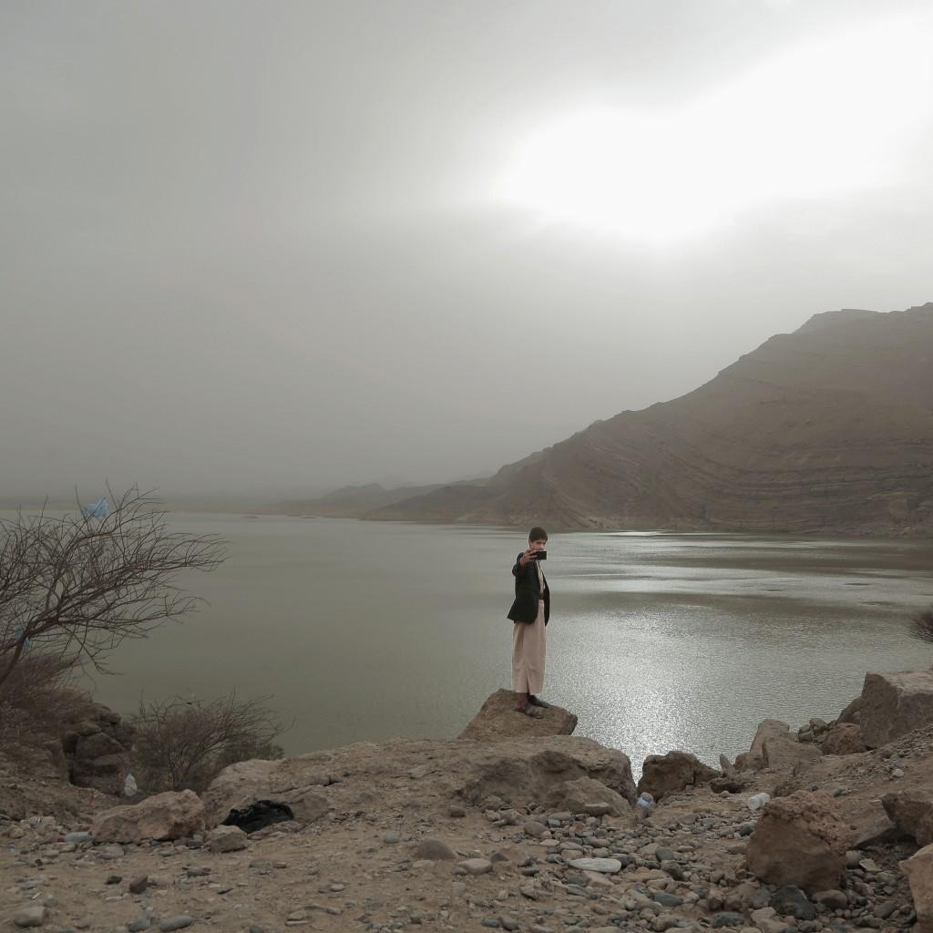 "A boy takes a ""selfie"" photo at the Marib Dam in Yemen on July 30, 2018. (AP Photo/Nariman El-Mofty)"