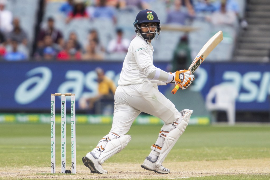 India's Ravindra Jadeja bats during play on day four of the third cricket test between India and Australia in Melbourne, Australia, Saturday, Dec. 29,...