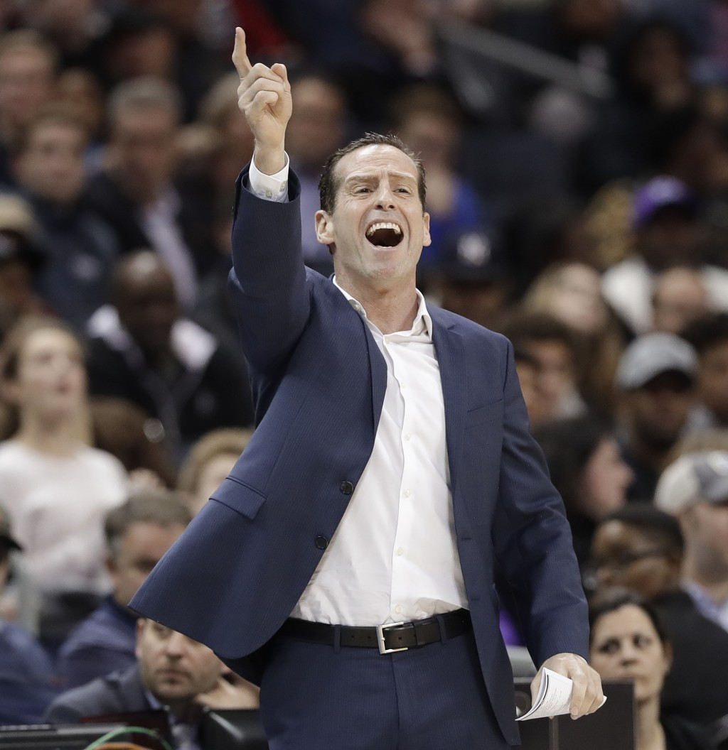 Brooklyn Nets coach Kenny Atkinson gestures during the first half of the team's NBA basketball game against the Charlotte Hornets in Charlotte, N.C., ...