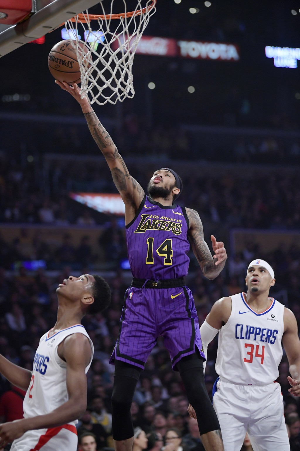 Los Angeles Lakers forward Brandon Ingram shoots as Los Angeles Clippers guard Shai Gilgeous-Alexander, left, and forward Tobias Harris defend during ...