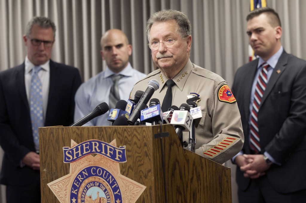 Kern County Sheriff Donny Youngblood, center, speaks at a news conference in Bakersfield, Calif., after suspect Gustavo Perez Arriaga surrendered and ...