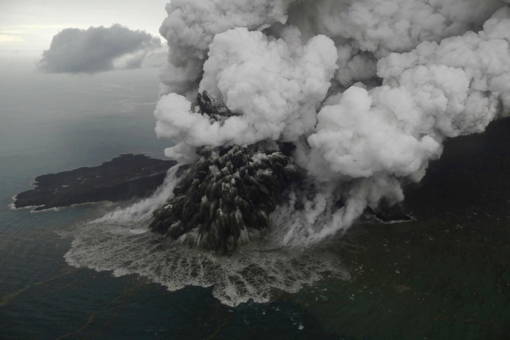 Plumes rise from Mount Anak Krakatau as it erupts in the Java Strait, Indonesia on Sunday, Dec. 23, 2018. A deadly tsunami followed an eruption and ap...