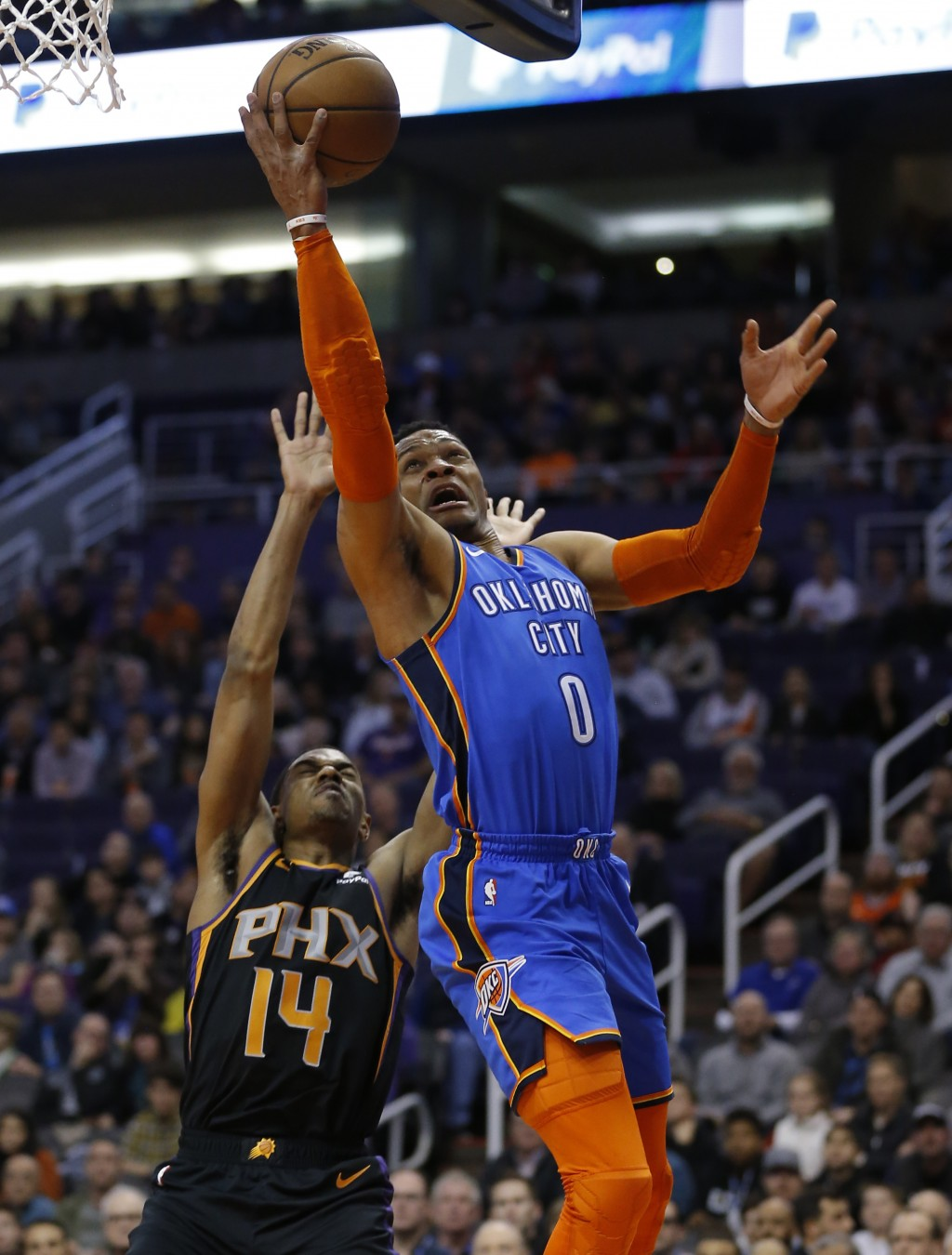 Oklahoma City Thunder guard Russell Westbrook (0) drives past Phoenix Suns guard De'Anthony Melton in the first half during an NBA basketball game, Fr...