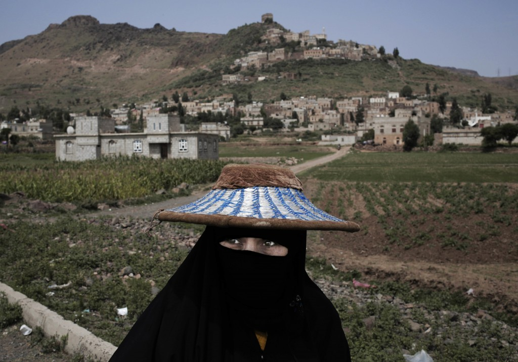"""In this Aug. 3, 2018 photo, a woman walks through Ibb, Yemen. Travelling across Yemen, an Associated Press team found """"in-between"""" moments everywhere ..."""