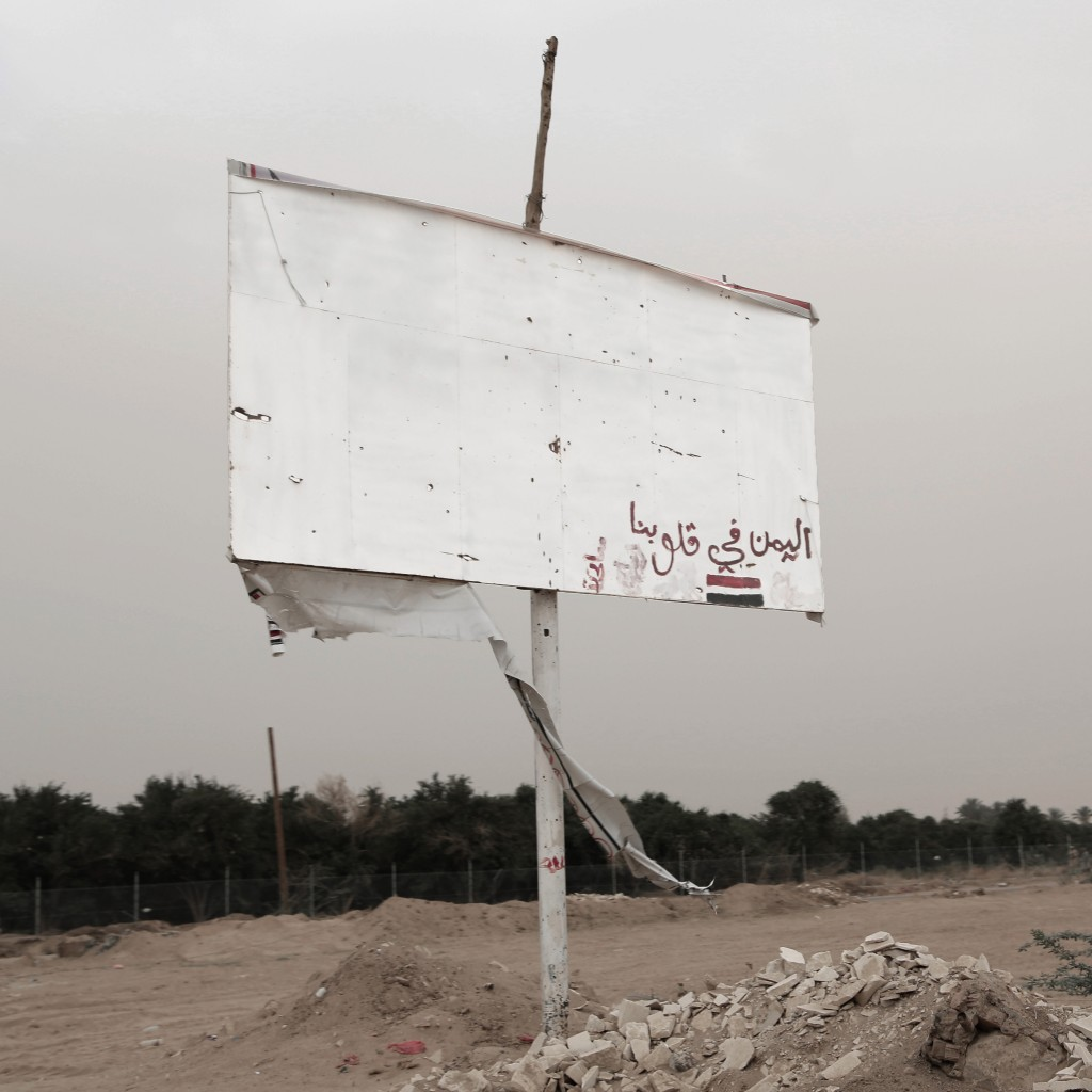 """This July 30, 2018 photo shows a damaged billboard with Arabic that reads, """"Yemen is in our hearts,"""" in Marib, Yemen. (AP Photo/Nariman El-Mofty)"""