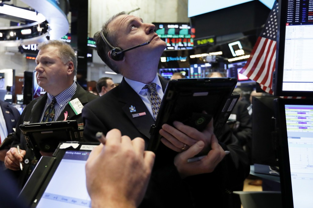 Trader Jonathan Corpina, right works on the floor of the New York Stock Exchange, Friday, Dec. 28, 2018. Stocks are opening higher Friday as U.S. mark...