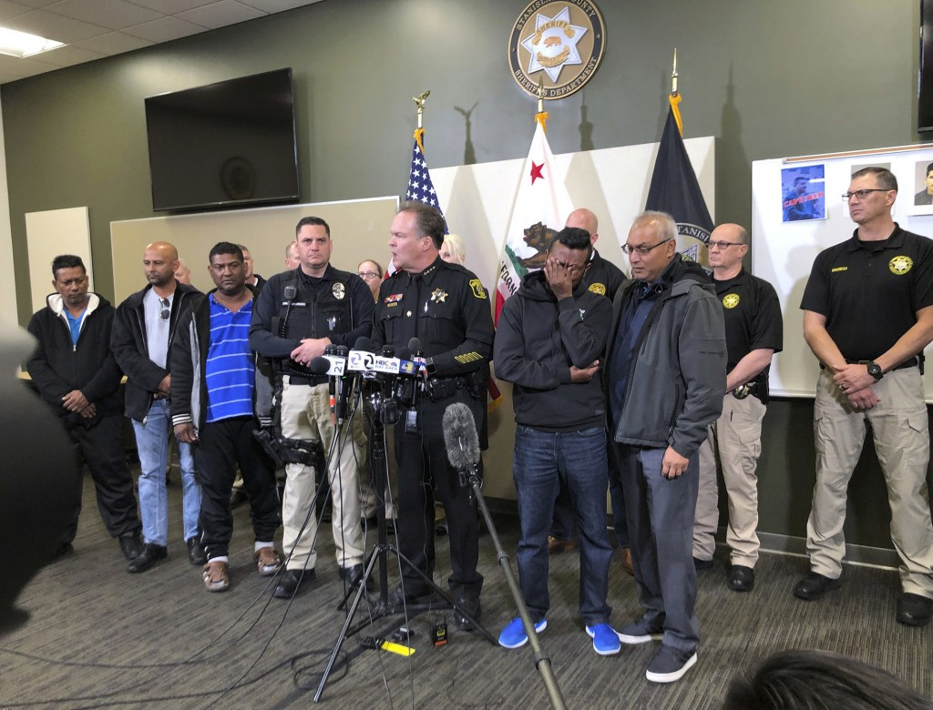 Law enforcement and family members of slain Newman Police officer Ronil Singh listen to Stanislaus County Sheriff Adam Christianson, center, talk abou...