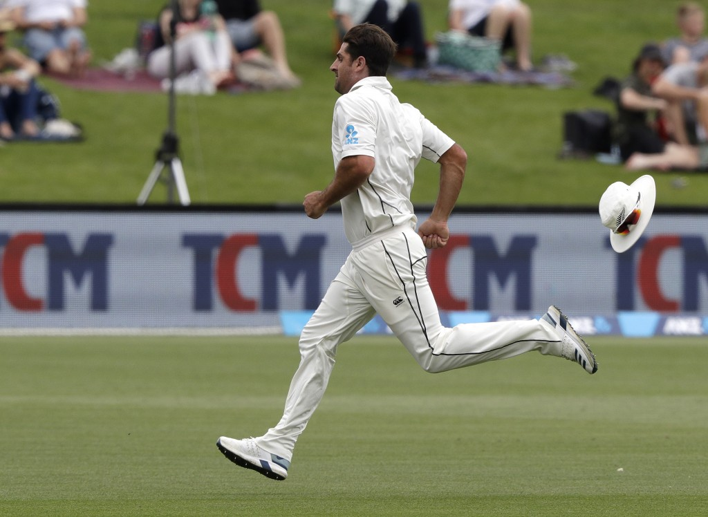 New Zealand's Colin de Grandhomme loses his hat as he chases after the ball during play on day four of the second cricket test between New Zealand and...