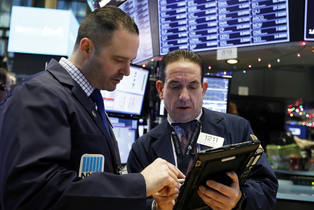 Executive Floor Governor Charles Caccese, left, and trader Tommy Kalikas consult on the floor of the New York Stock Exchange, Friday, Dec. 28, 2018. S...