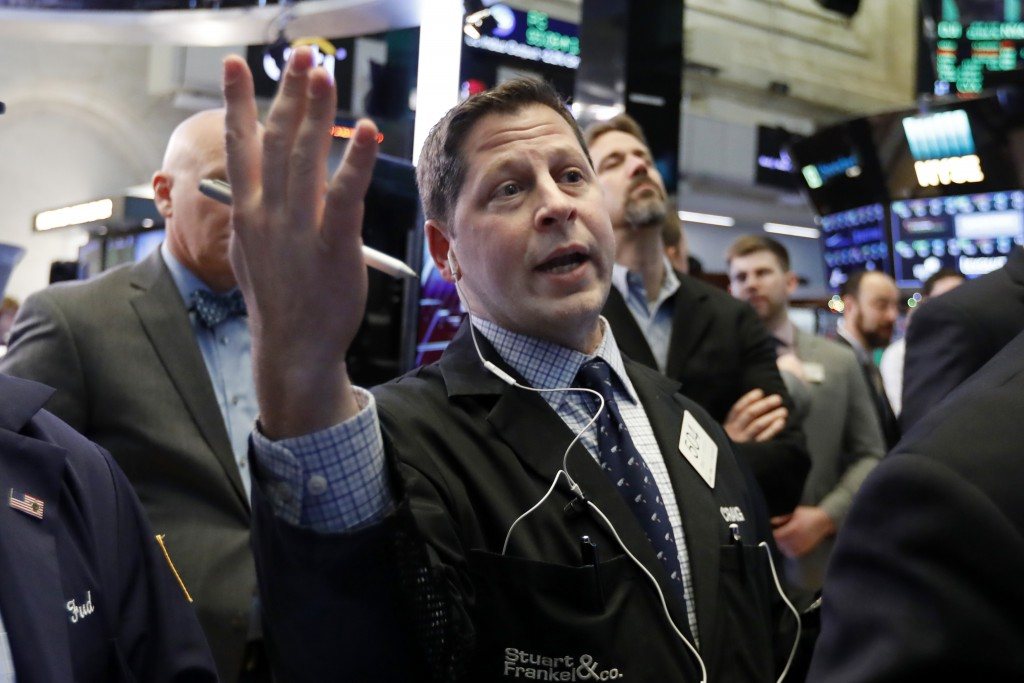 Trader Craig Esposito works on the floor of the New York Stock Exchange, Friday, Dec. 28, 2018. Stocks are opening higher Friday as U.S. markets try t...