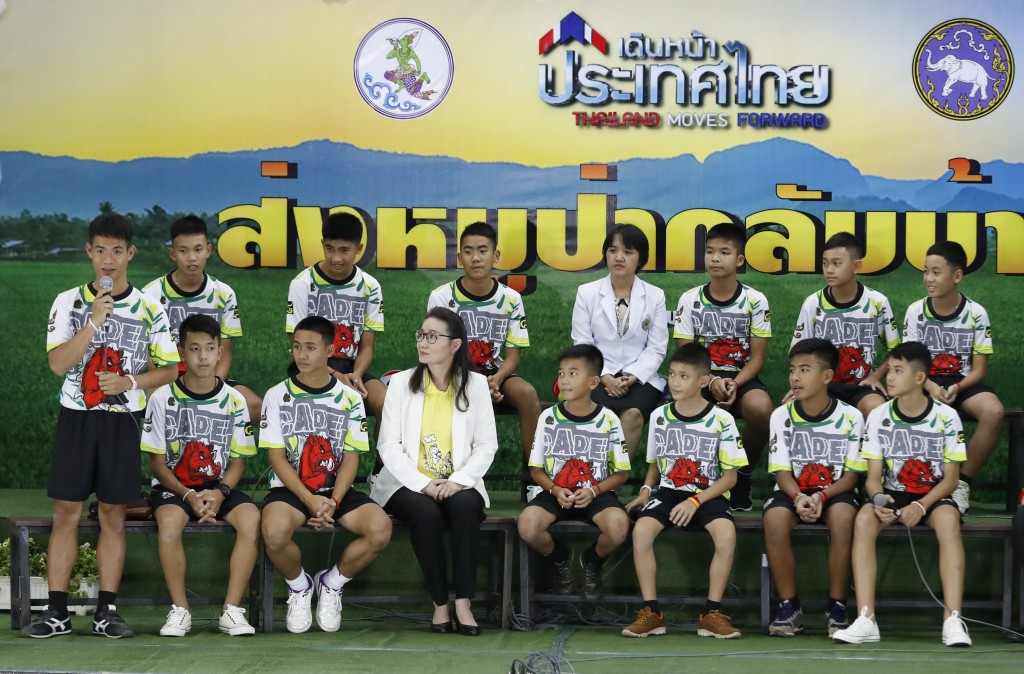 """FILE - In this file photo dated Wednesday, July 18, 2018, Coach"""" Ake"""" Ekkapol Janthawong, left, speaks on behalf of the 12 boys and himself about thei"""