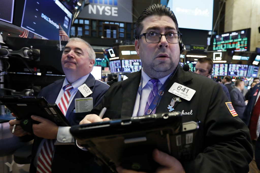 Trader Michael Capolino, right, works on the floor of the New York Stock Exchange, Friday, Dec. 28, 2018. Stocks are opening higher Friday as U.S. mar...