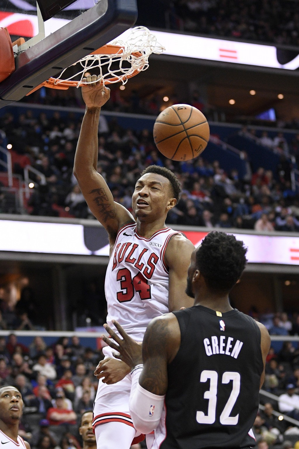 Chicago Bulls forward Wendell Carter Jr. (34) dunks over Washington Wizards forward Jeff Green (32) during the second half of an NBA basketball game, ...