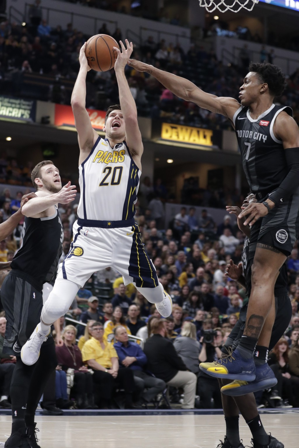 Indiana Pacers forward Doug McDermott (20) shoots next to Detroit Pistons forward Stanley Johnson (7) during the second half of an NBA basketball game...