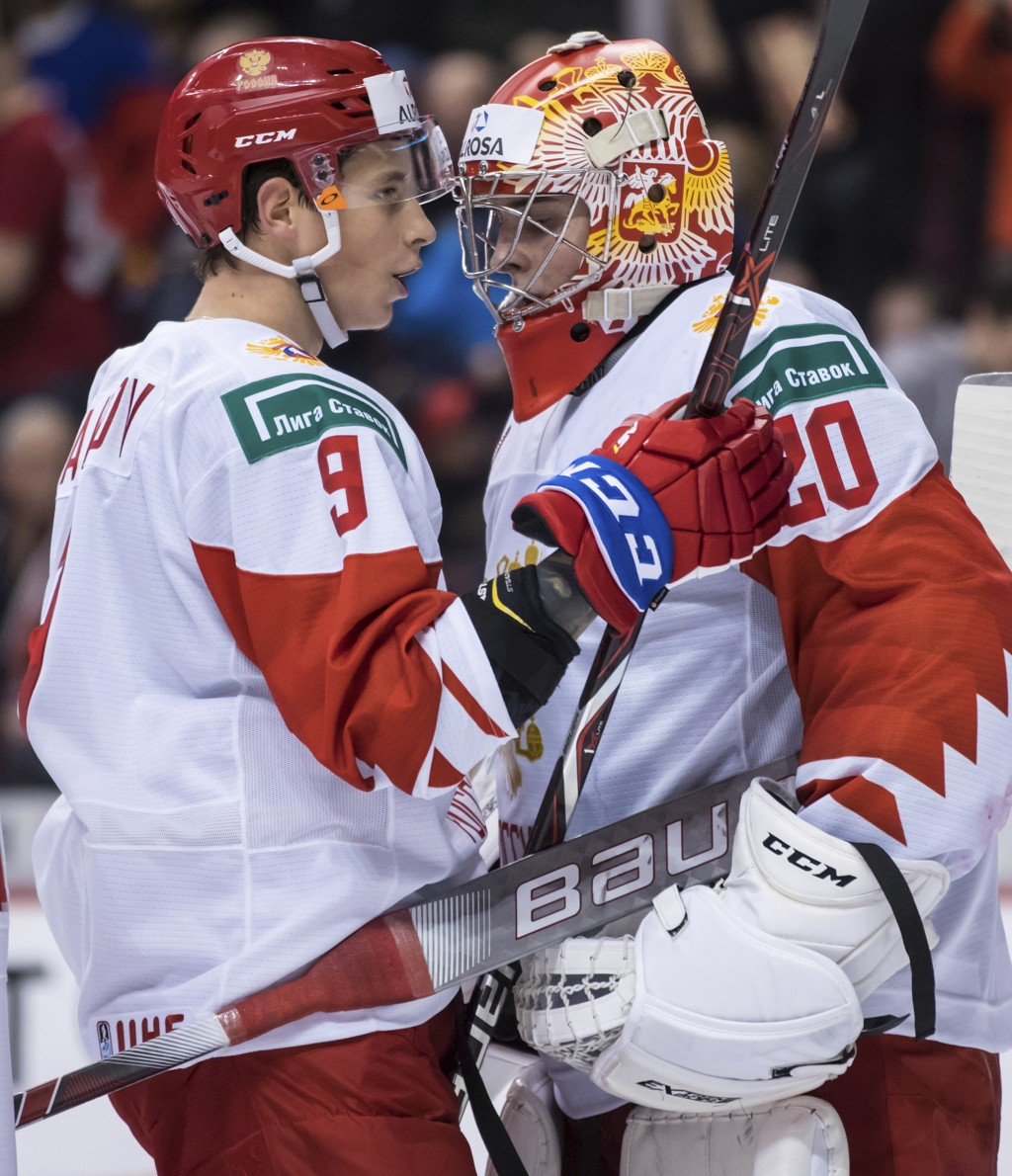 Russia's Artyom Galimov, left, and goalie Pyotr Kochetkov celebrate their win over the Czech Republic in IIHF world junior hockey championship game ac...