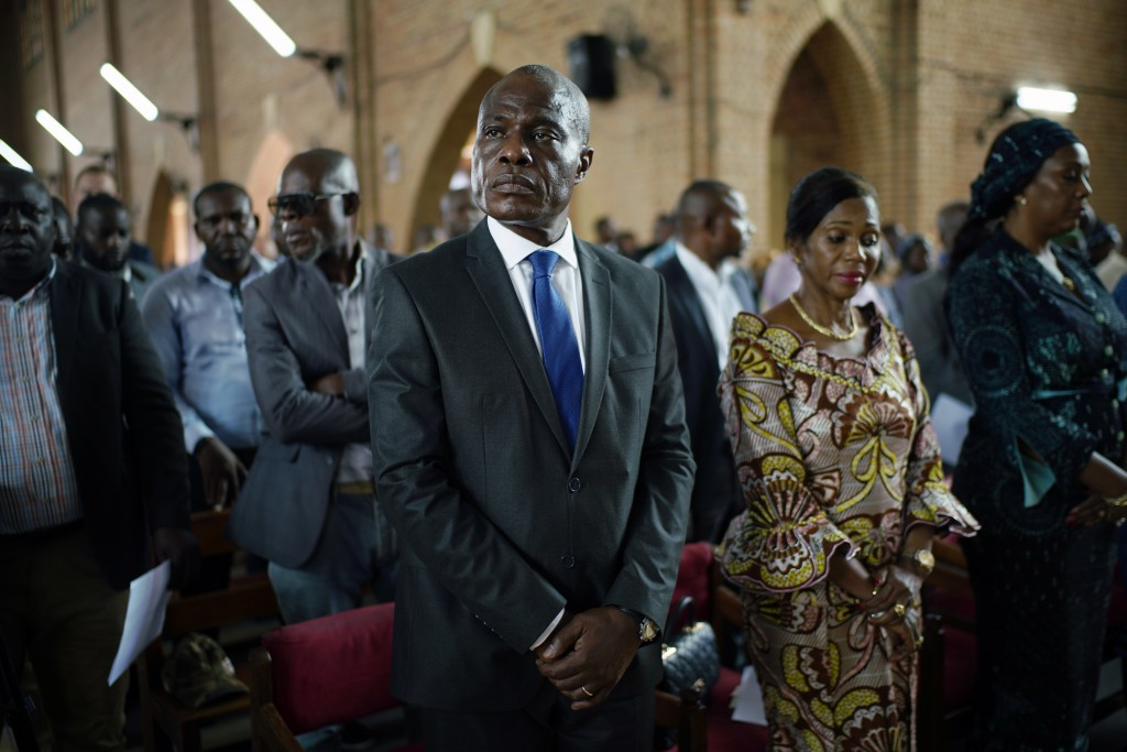 Congolese opposition presidential candidate Martin Fayulu attends a prayer service at Notre Dame du Congo cathedral in Kinshasa, Congo, Saturday Dec. ...