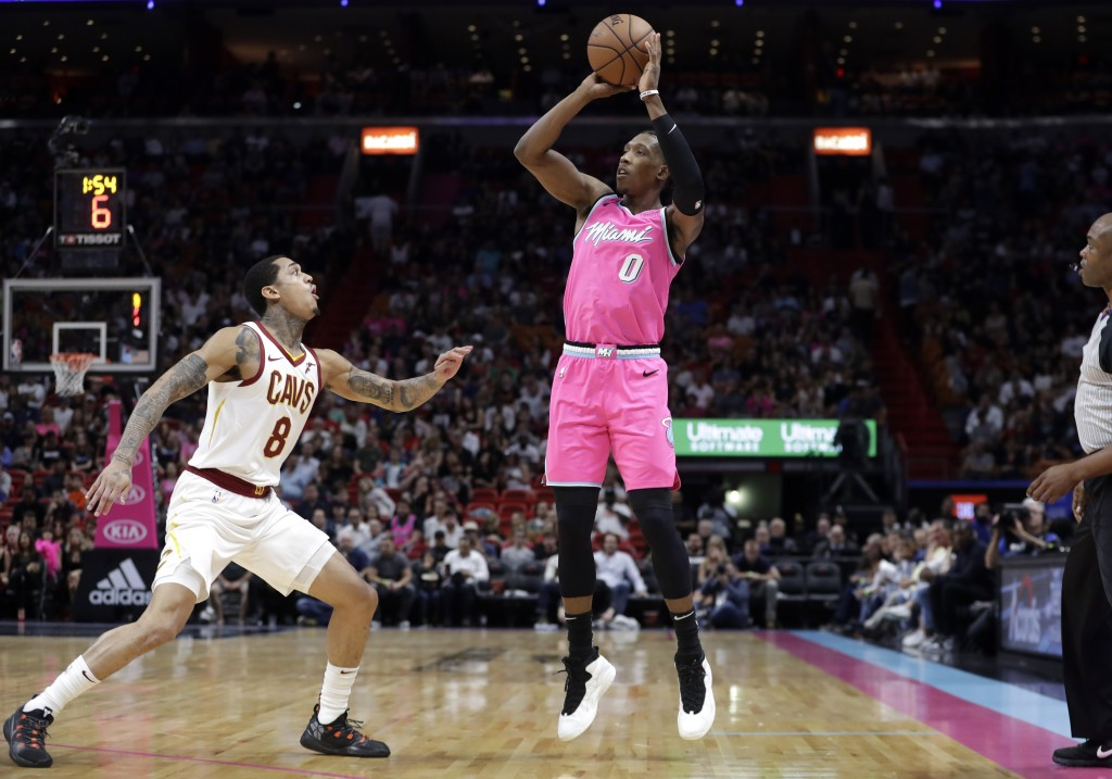 Miami Heat guard Josh Richardson (0) attempts a three-point basket over Cleveland Cavaliers guard Jordan Clarkson (8) during the first half of an NBA ...