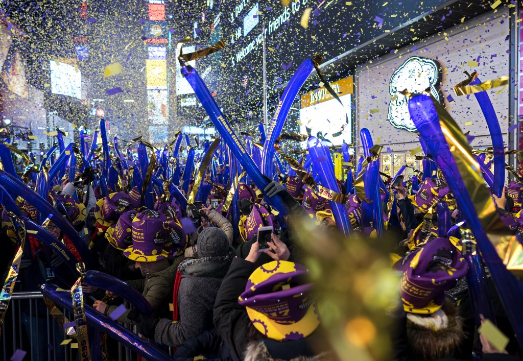 FILE - In this Dec. 31, 2016 file photo, confetti falls during one of the hourly countdowns as revelers take part in a New Year's Eve celebration in N...