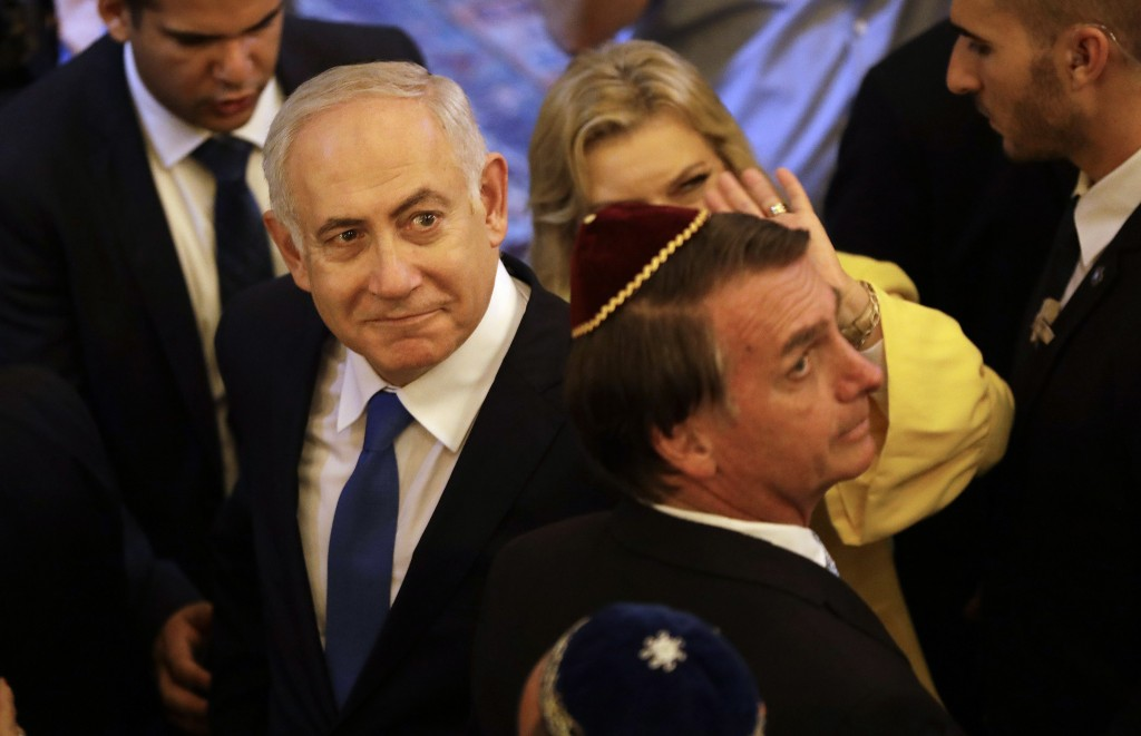 Israel's Prime Minister Benjamin Netanyahu and Brazil's President-elect Jair Bolsonaro, exit after a visit to the Kehilat Yaacov synagogue, in Rio de ...