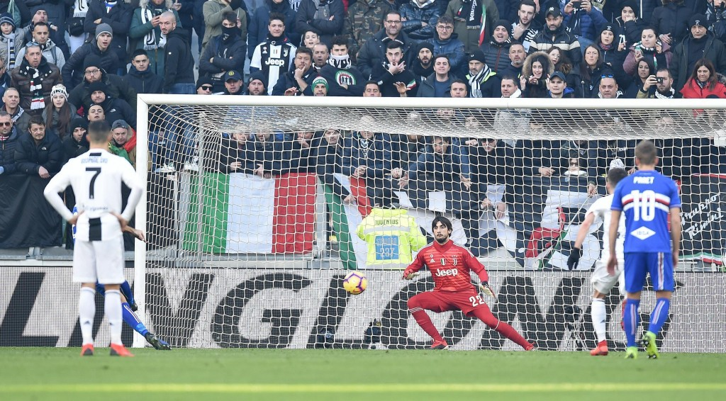 Sampdoria's Fabio Quagliarella, background second from left, equalizes on a penalty kick during the Italian Serie A soccer match between Juventus and ...