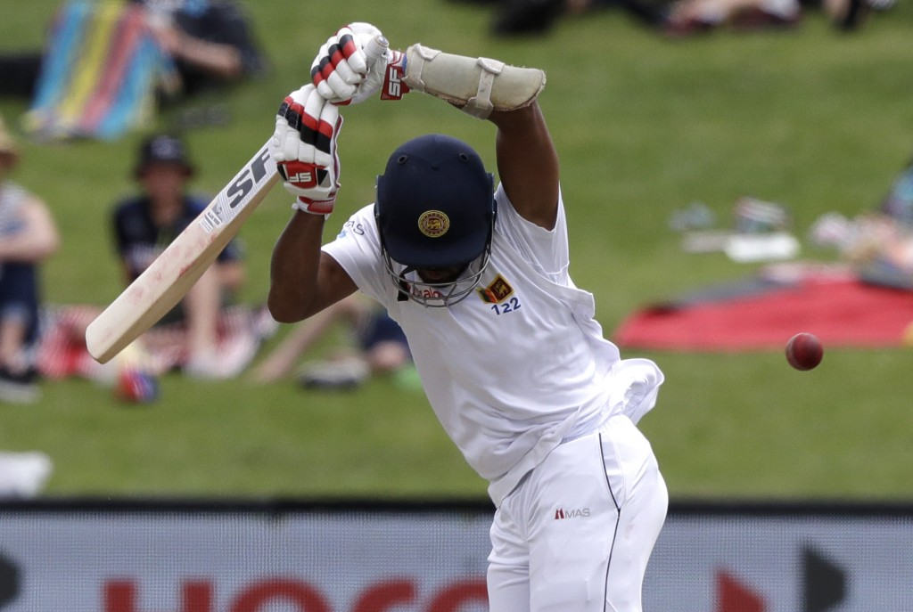 Sri Lanka's Dinesh Chandimal lets the ball pass while batting during play on day four of the second cricket test between New Zealand and Sri Lanka at ...