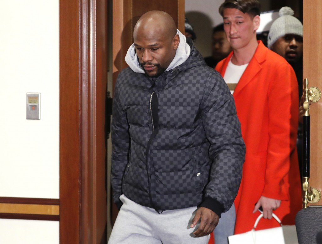 Floyd Mayweather Jr. walks into venue for a news conference in Tokyo Saturday, Dec. 29, 2018. Mayweather is scheduled to fight Japanese kickboxer Tens...