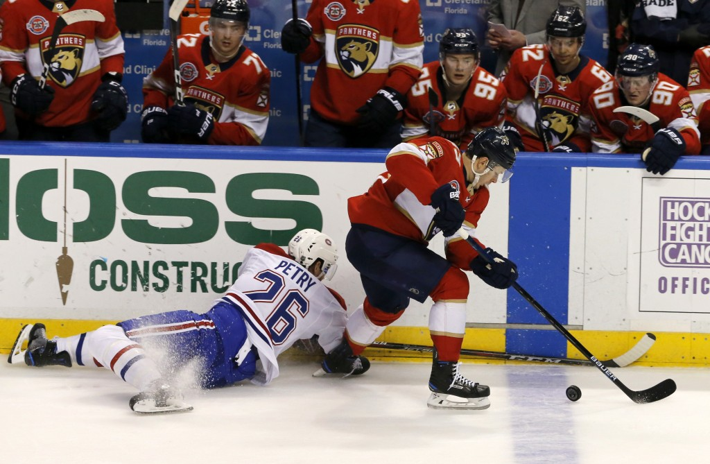 Florida Panthers right wing Evgenii Dadonov, right, tries to elude Montreal Canadiens defenseman Jeff Petry (26) in the second period of an NHL hockey...