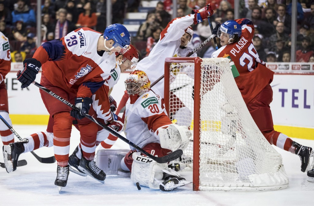Russia goalie Pyotr Kochetkov (20) stops Czech Republic's Jachym Kondelik (29) during third-period IIHF world junior hockey championship game action i...