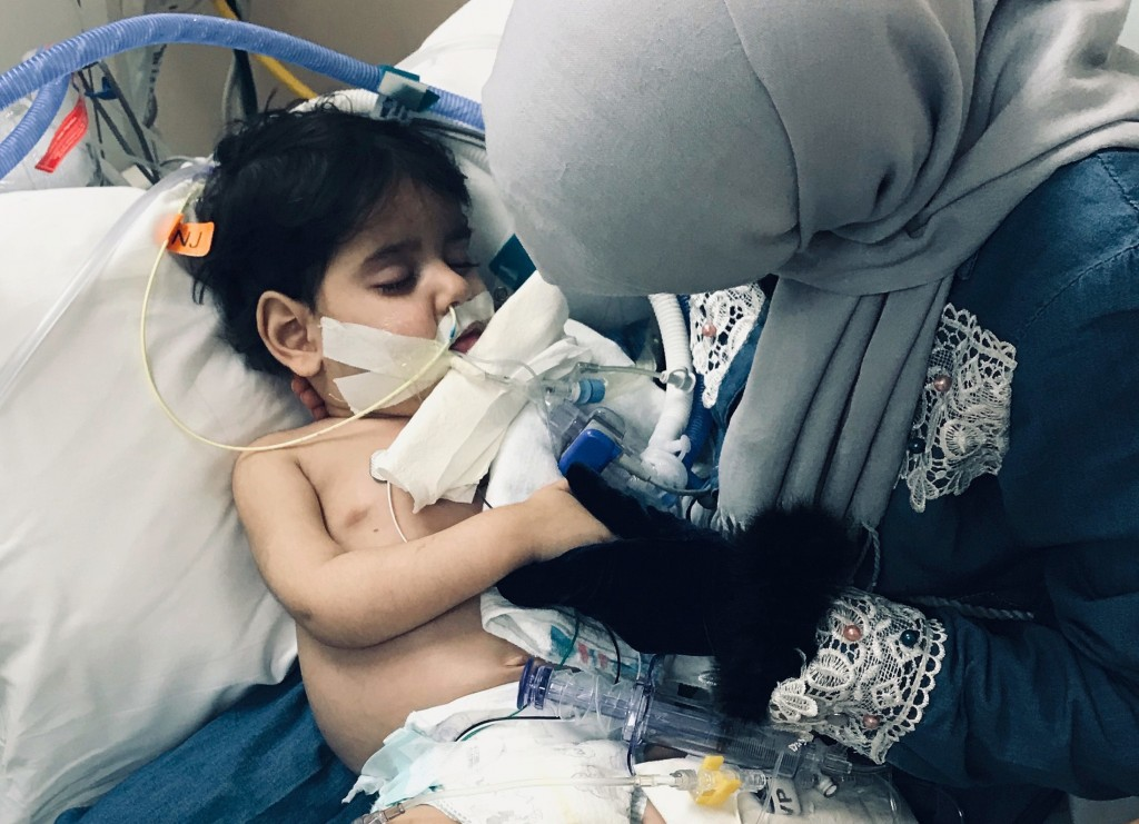 In this December 2018 photo released by the Council on American Islamic Relations, Sacramento Valley, Shaima Swileh, of Yemen, holds her dying 2-year ...