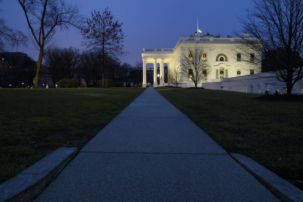 The White House is seen, Friday, Dec. 28, 2018, in Washington. The partial government shutdown will almost certainly be handed off to a divided govern