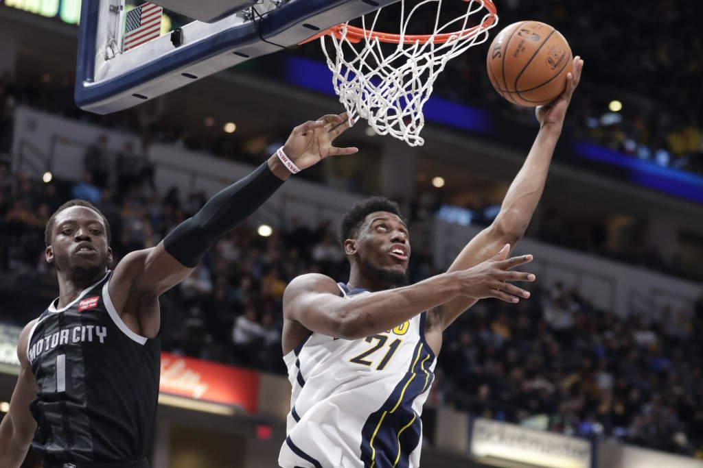 Indiana Pacers forward Thaddeus Young (21) shoots in front of Detroit Pistons guard Reggie Jackson (1) during the second half of an NBA basketball gam...