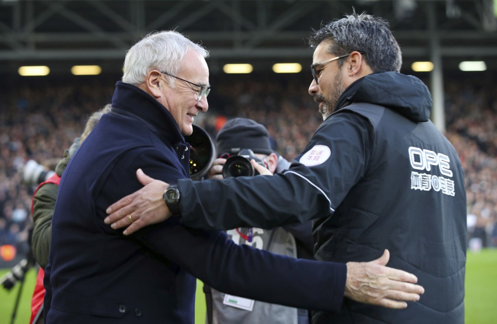 Fulham Manager Claudio Ranieri, left, and Huddersfield Town manager David Wagner shake hands ahead of their English Premier League soccer match at Cra...