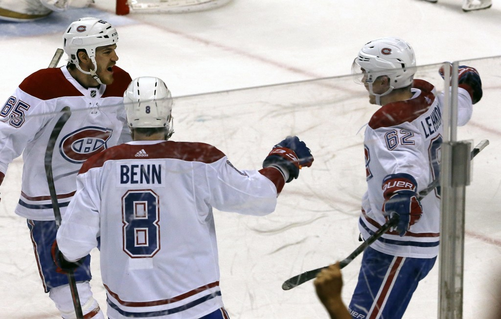 Montreal Canadiens left wing Artturi Lehkonen (62) celebrates his winning goal with teammates Jordie Benn (8) and Andrew Shaw (65) in the third period...