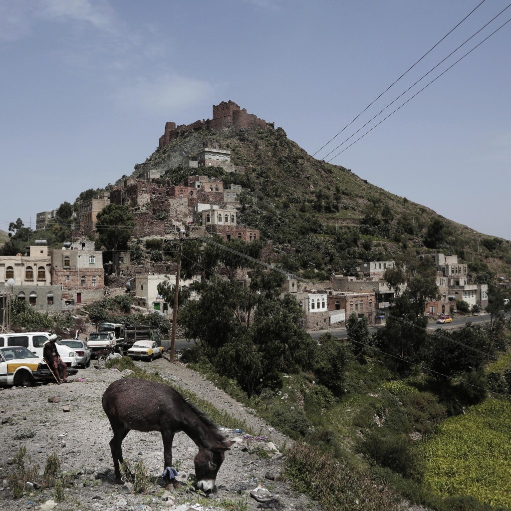 This Aug. 3, 2018 photo, shows an ancient site, top, known as Samara Castle, in Ibb, Yemen. (AP Photo/Nariman El-Mofty)