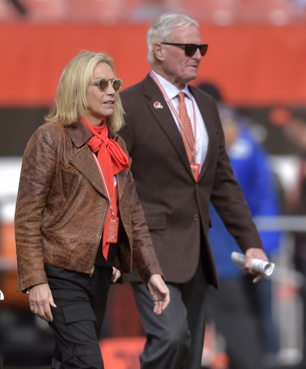 File-This Nov. 4, 2018, file photo shows, Cleveland Browns owners Dee and Jimmy Haslam walk on the field prior to an NFL football game against the Kan...