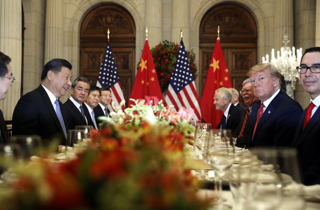 In this Dec. 1, 2018, file photo, U.S. President Donald Trump, second right, and China's President Xi Jinping, second left, attend their bilateral mee...
