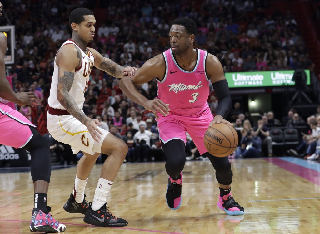 Miami Heat guard Dwyane Wade (3) handles the ball as Cleveland Cavaliers guard Jordan Clarkson defends during the first half of an NBA basketball game...